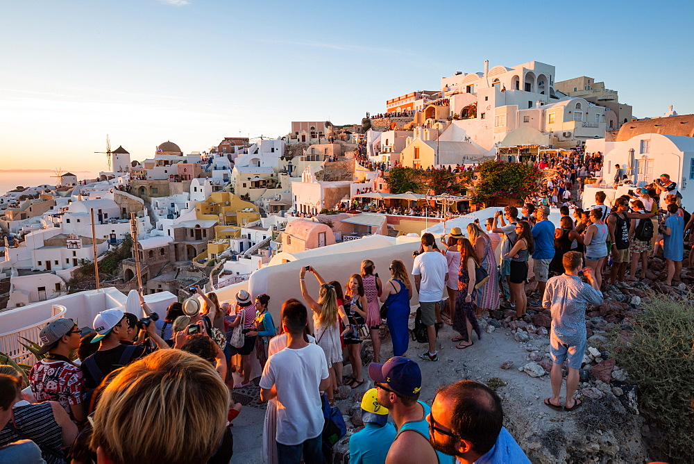 Behind the scenes of a famous Oia sunset on the Greek island of Santorini. People line every part the town's walls. - 1263-9