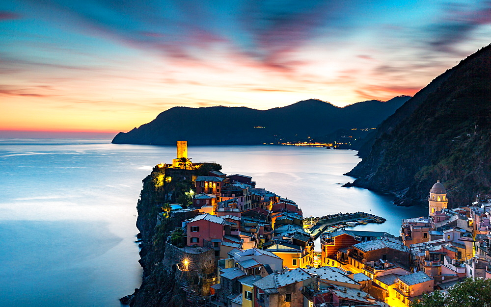 Long exposure at blue hour to capture the end of a stunning sunset and the lights of the old town, Vernazza, Cinque Terre, UNESCO World Heritage Site, Liguria, Italy, Europe