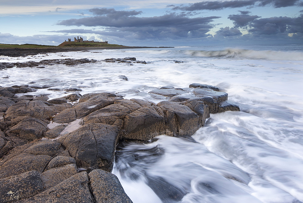 Dunstanburgh castle from the rocky shore close to Craster, Northumberland, England, United Kingdom, Europe - 1266-102