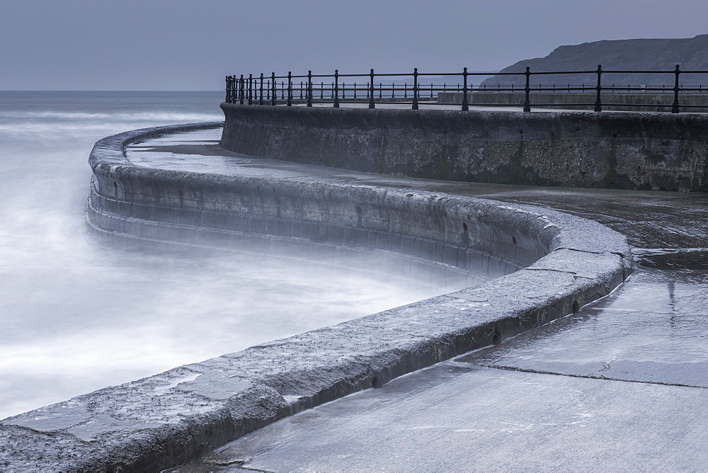 Long exposure showing part of the sea wall at Scarborough, North Yorkshire, UK