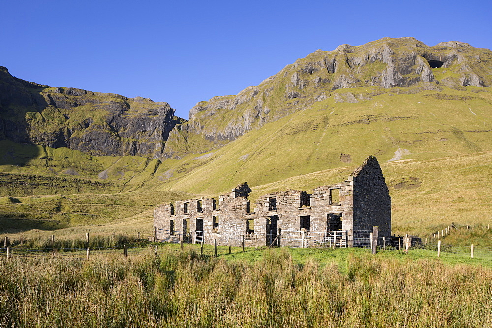 Ruined farmhouse beneath the rocky escarpment of Benbulbin, County Sligo, Republic of Ireland - 1266-53