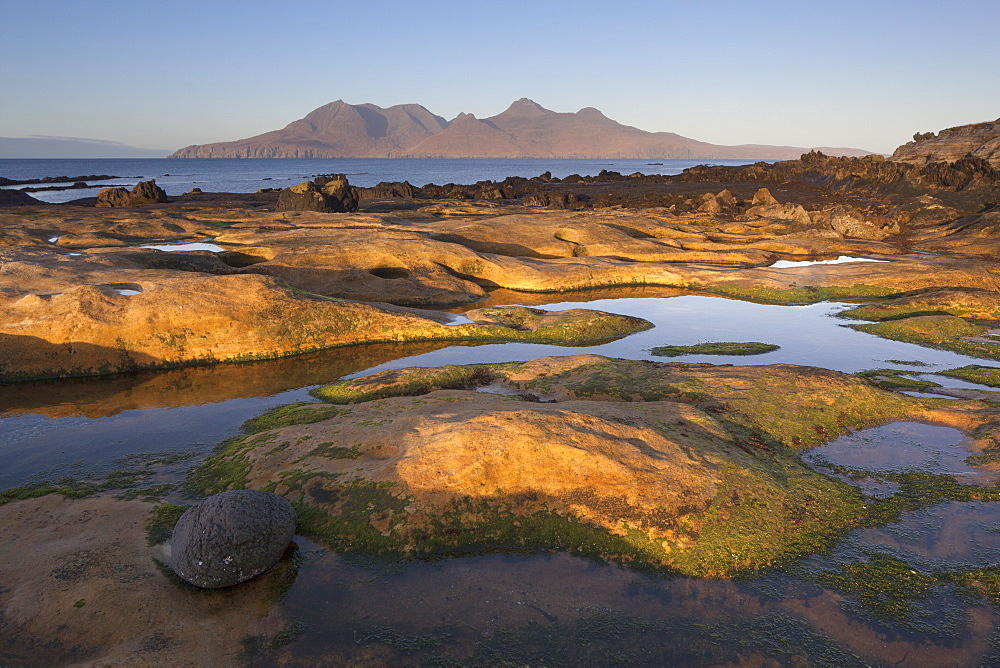 The Isle of Rum from Singing Sands on the Isle of Eigg, Small Isles, Inner Hebrides, Scottish Highlands, Scotland, UK - 1266-58