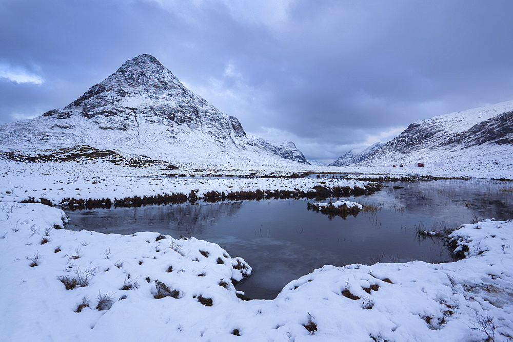 View to a snow covered Buachaille Etive Beag from Lochan na fola close to the A82 through Glencoe, Lochaber, Highlands, Scotland, United Kingdom, Europe - 1266-64