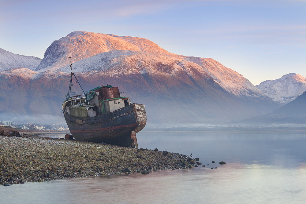 Wreck of old fishing boat and view towards the snow capped peak of Ben Nevis from Loch Linnhe, Lochaber, Scottish Highlands, Scotland, United Kingdom, Europe - 1266-81