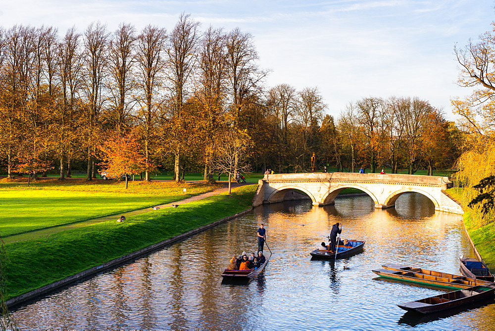 Punting on the Backs with the late evening light hitting Trinity College bridge, Cambridge, Cambridgeshire, England, United Kingdom, Europe