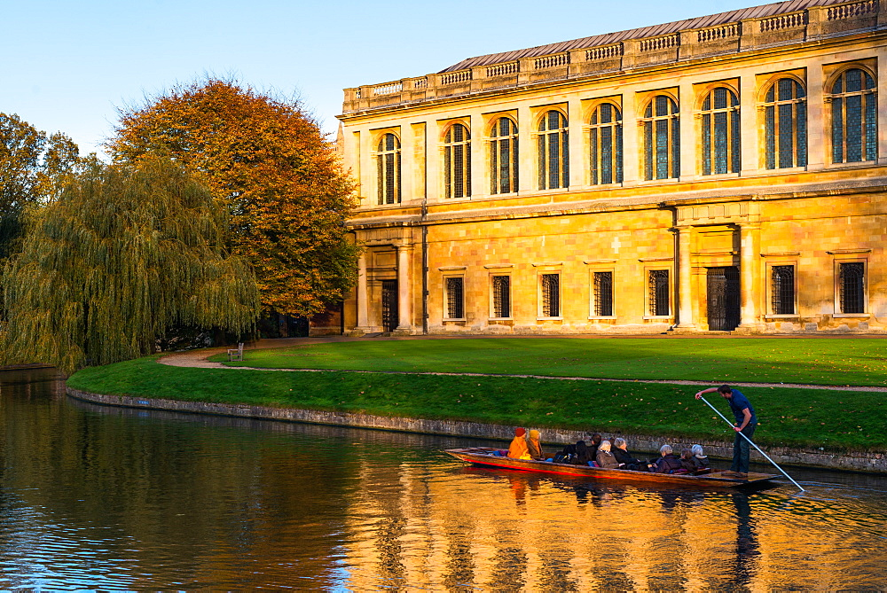 Punting on river Cam with Trinity College's Wren Library. Cambridge University, England, UK.