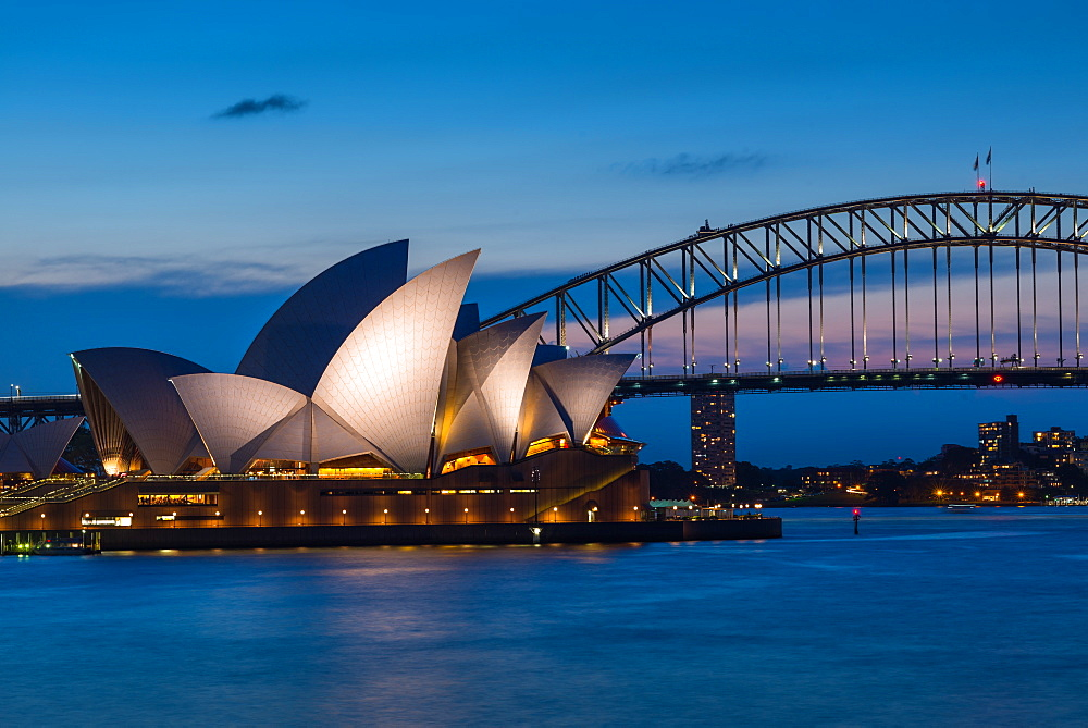 Sydney Opera House, UNESCO World Heritage Site, and Harbour Bridge after sunset, Sydney, New South Wales, Australia, Pacific