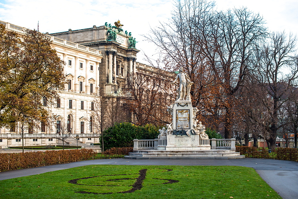 Mozart statue in Burggarten in front of Neue Burg building, part of the Hofburg Palace, Vienna, Austria, Europe