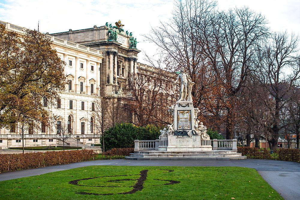 Mozart statue in Burggarten in front of Neue Burg building, part of the Hofburg palace, Vienna, Austria.