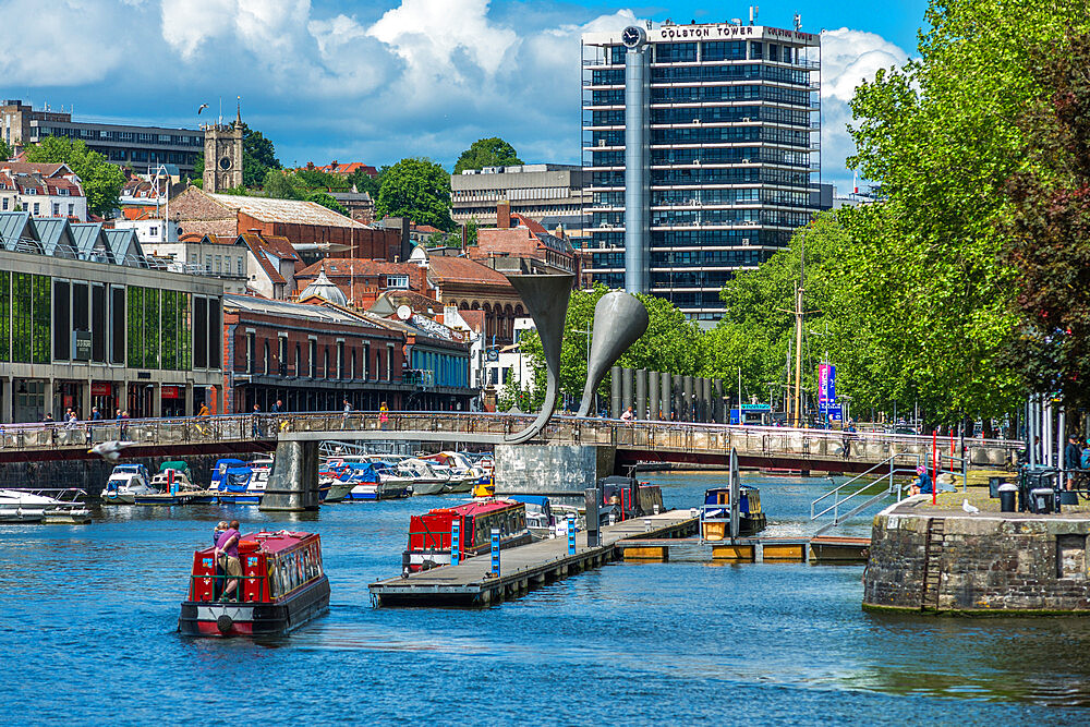 City skyline with canal boats at Pero's Bridge across the Floating Harbour, Harbourside, Bristol, England, United Kingdom - 1267-516