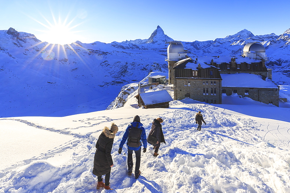 Tourists walks in the snow near the astronomical observatory of Gornergrat, Zermatt, Canton of Valais / Wallis, Switzerland. - 1269-116
