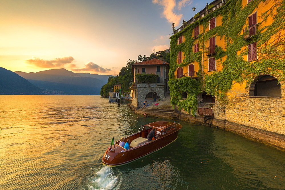 A boat of tourists stops to observe the sunset. Nesso, Province of Como, Como Lake, Lombardy, Italy, Europe. - 1269-256