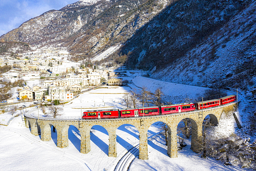 Bernina Express passes over the helical (spiral) viaduct of Brusio, UNESCO World Heritage Site, Valposchiavo, Canton of Graubunden, Switzerland, Europe