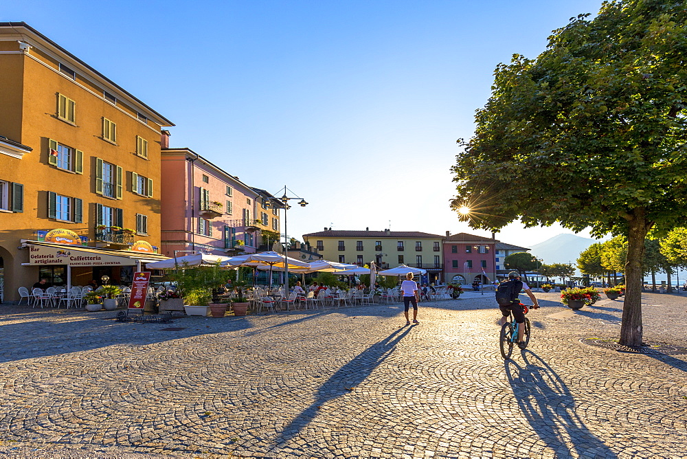 Colourful square of the village of Colico with passing tourists, Lake Como, Lombardy, Italian Lakes, Italy, Europe