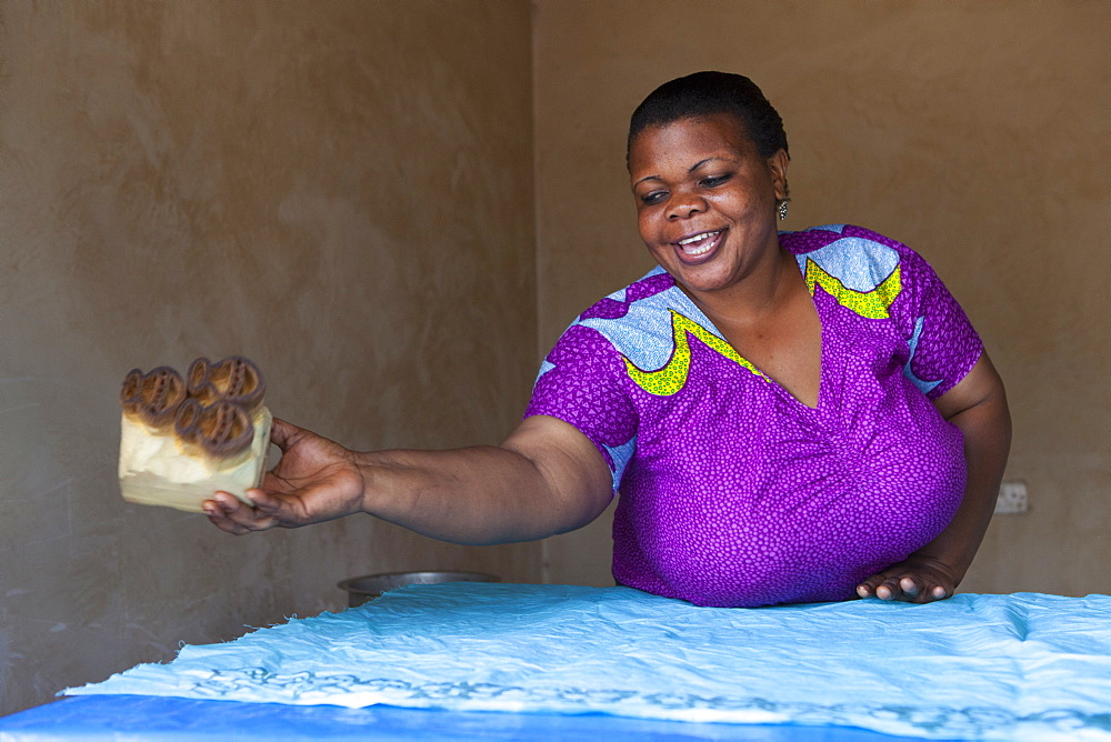 A woman making a new batik print, Tanzania, East Africa, Africa