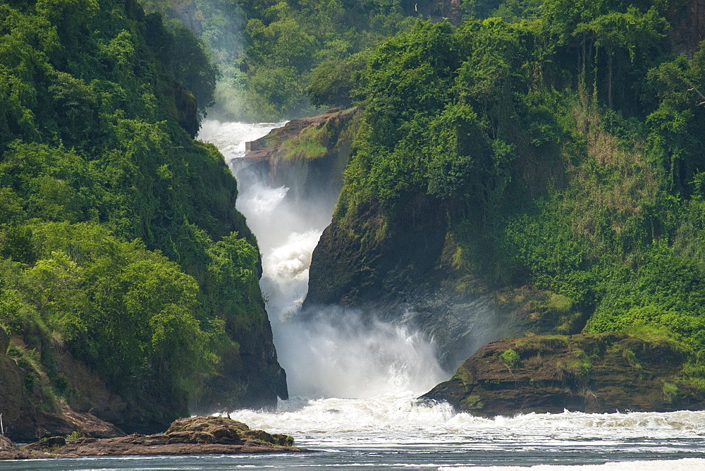 Water cascades down Murchison Falls and into the River Nile, Uganda, Africa - 1270-113
