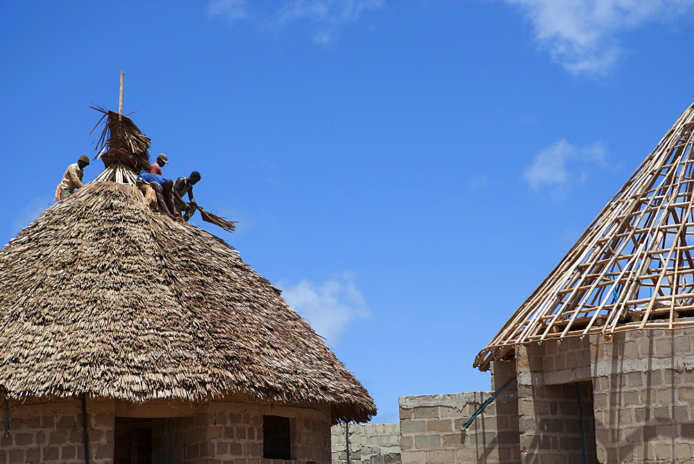Men thatching the roof of a new house, Tanzania, East Africa, Africa - 1270-119