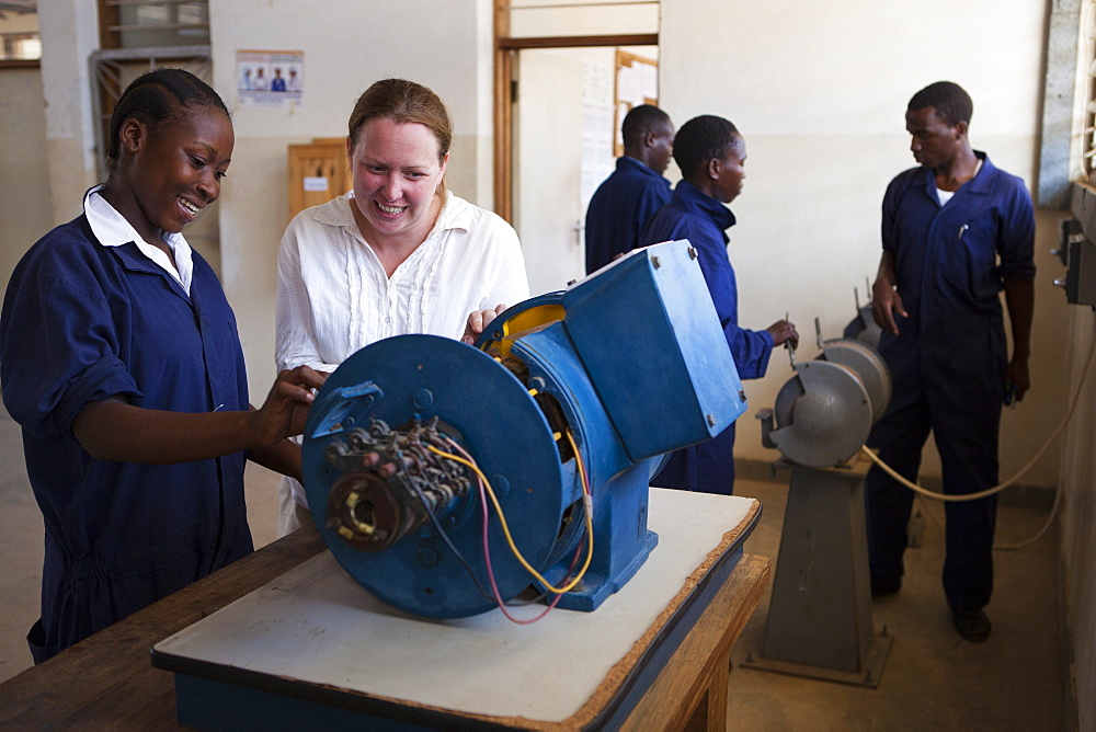 A VSO volunteer teaching a female electrician, Tanzania, East Africa, Africa