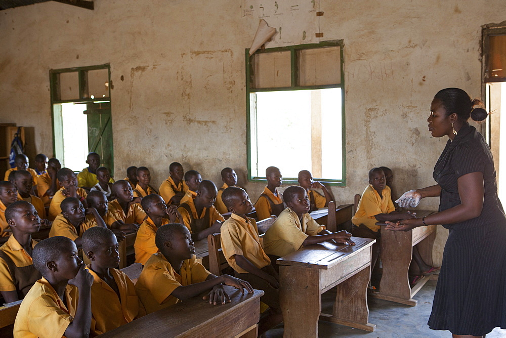 A female teacher teaching science to a classroom of students at a primary school, Ghana, West Africa, Africa - 1270-150