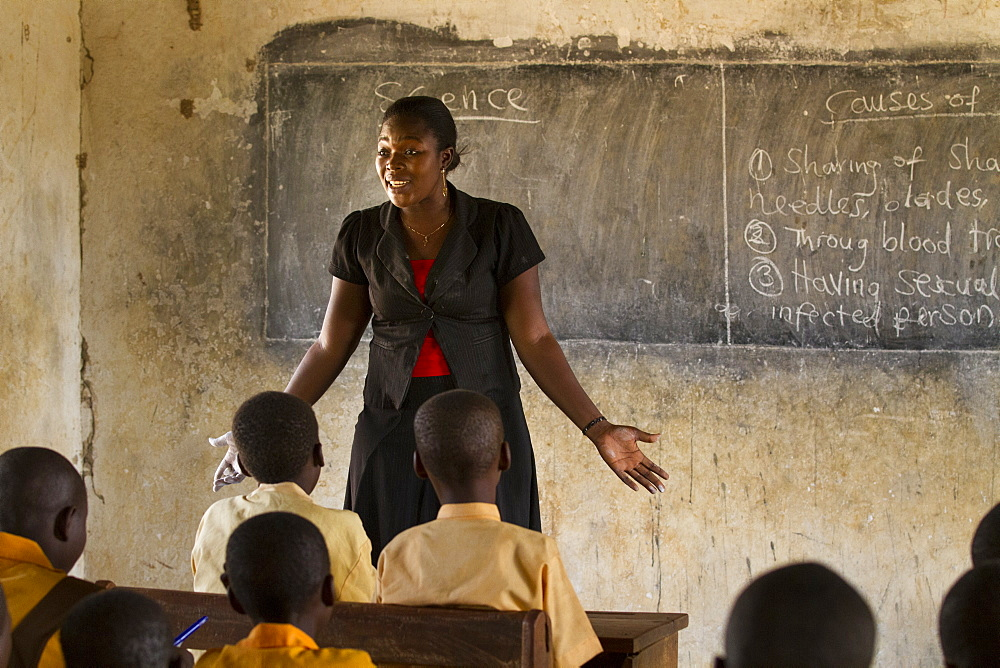 A female teacher teaching science to a classroom of students at a primary school, Ghana, West Africa, Africa - 1270-152