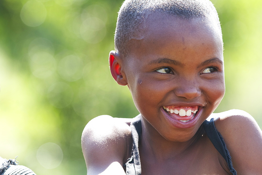 A young girl smiling and looking off to the right, Lesotho, Africa - 1270-62