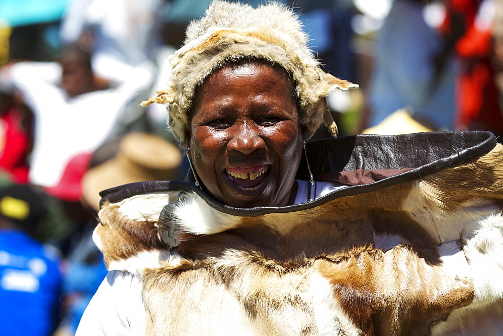 A lady dances and celebrates in traditional costume, Lesotho, Africa