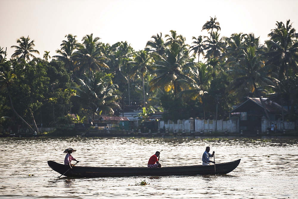 Dugout canoe fishing boat in the backwaters near Alleppey (Alappuzha), Kerala, India, Asia