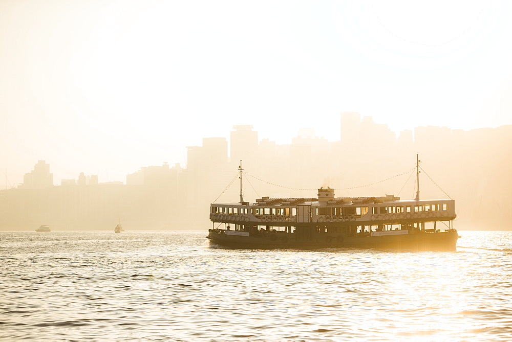 Star Ferry at sunset, between Hong Kong Island and Kowloon, Hong Kong, China, Asia - 1272-275