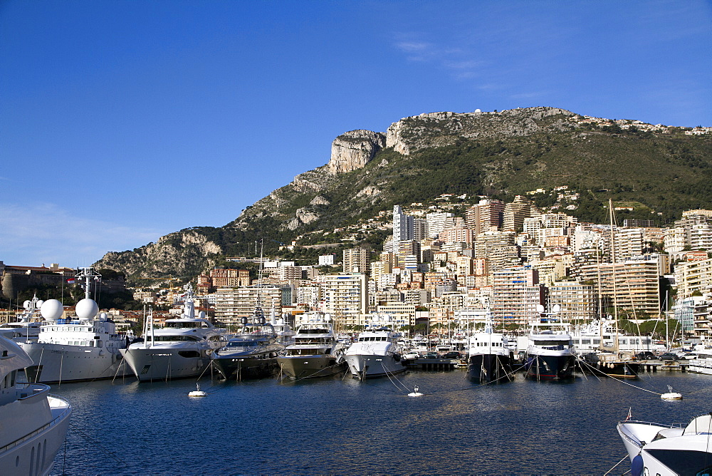View of the harbour of Monaco Ville (Porte Hercule) with its luxury ships, Monaco, French Riviera, Mediterranean, Europe