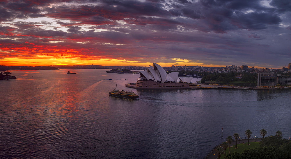 Dramatic sunrise at the Sydney Harbour, with a view of the Sydney Opera House, UNESCO World Heritage Site, Sydney, New South Wales, Australia, Pacific