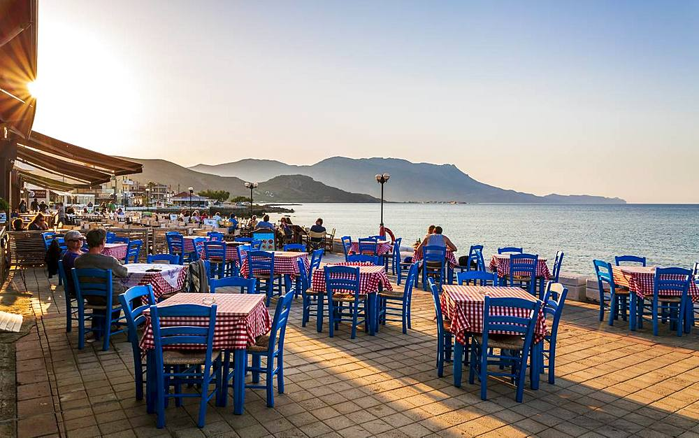 Restaurant at Paraliaki promenade at sunset in Kissamos, Crete, Greek Islands, Greece, Europe