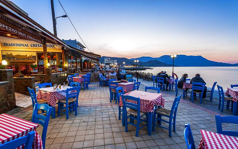 Traditional Cretan Food Restaurant at Paraliaki promenade at sunset in Kissamos, Crete, Greek Islands, Greece, Europe