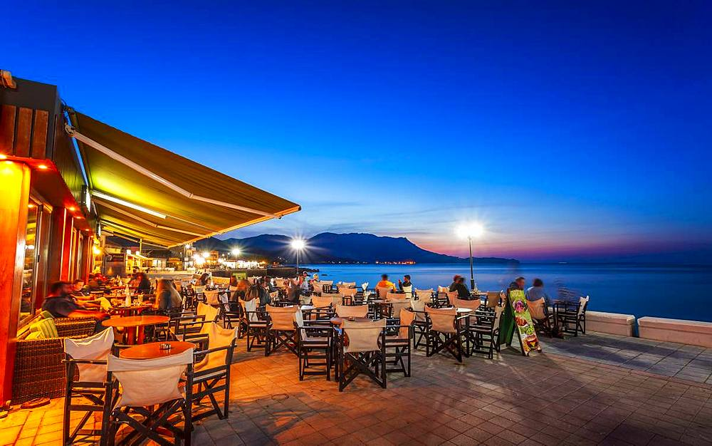 Traditional Cretan Food Restaurant at Paraliaki promenaad at sunset in Kissamos, Crete, Greek Islands, Greece, Europe - 1276-134