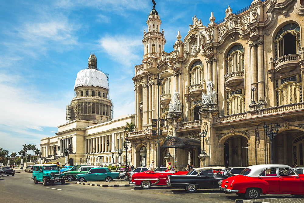 Old American taxi cars parked outside the Gran Teatro de La Habana and El Capitolio, Havana, Cuba, West Indies, Caribbean, Central America