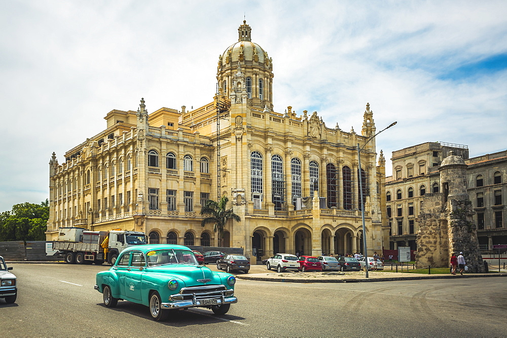 Old classic car and The former Presidential Palace, The Museum of the Revolution in Old Havana, Cuba, West Indies, Caribbean