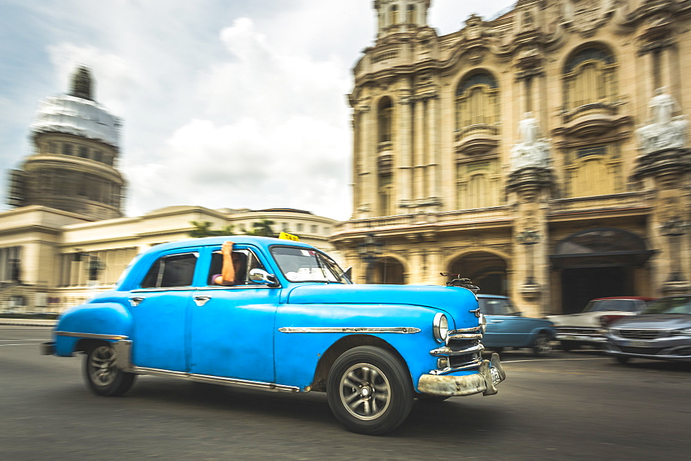 A Turquoise American classic car taxi outside El Capitolio in Havana, La Habana, Cuba, West Indies, Caribbean, Central America