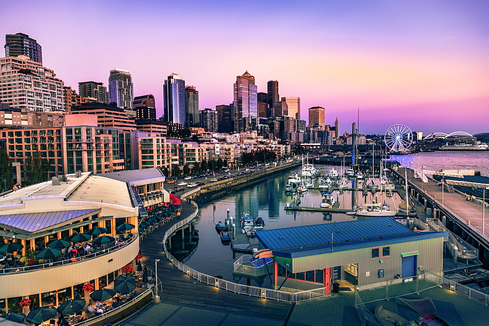 Sunset over Bell Harbor Marina on the Seattle Waterfront with city's skyline in the background, Seattle, Washington State, United States of America, North America