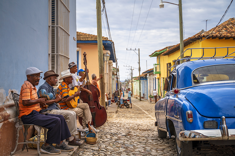 Elderly Cubans playing music on the street, American classic car, Trinidad, Sancti Spiritus Province, Cuba, Central America
