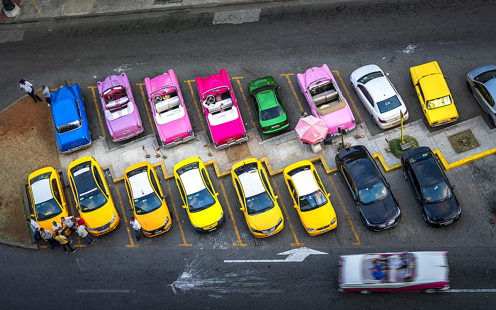 Aerial view of colourful old American taxi cars parked in Havana at dusk, La Habana, Cuba, West Indies, Caribbean