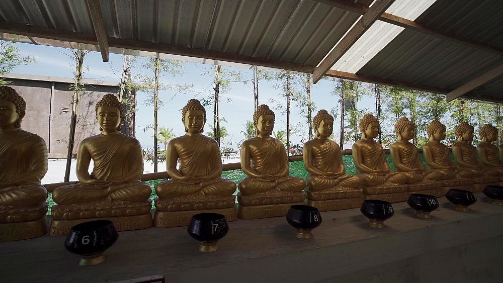 4k video of gold buddha statues at The Big Buddha (The Great Buddha) in Phuket, Thailand, Southeast Asia, Asia