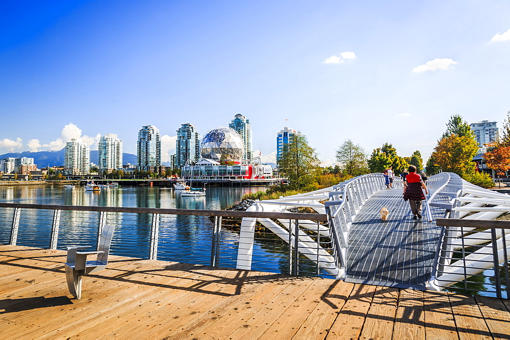 View of False Creek and city skyline, World of Science Dom, people walking, Vancouver, British Columbia, Canada, North America