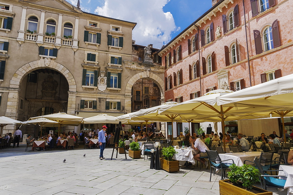 Piazza dei Signori, with crowd eating at restaurants in front of Palazzo Domus Nova on left and Casa della Pieta on right, Verona, Veneto, Italy, Europe - 1278-126