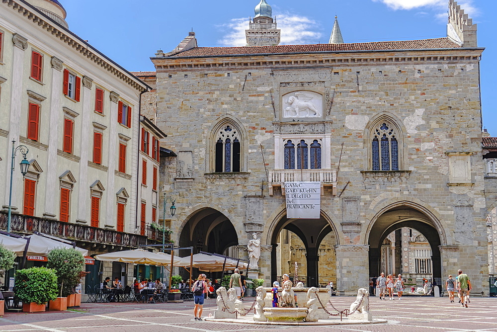 Bergamo, Italy Old Town Palace. Palazzo Delle Ragione day view at Piazza Vecchia with fountain and crowd in Citta Alta. - 1278-153