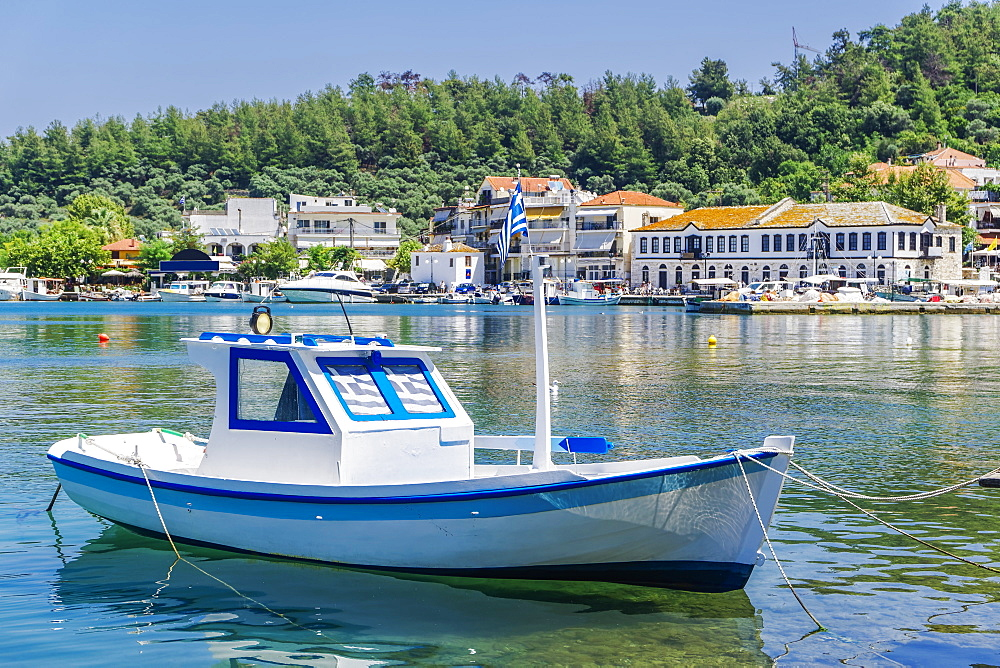 Moored small white boat with Greek flags, Limenas Town, Thassos island, Greek Islands, Greece, Europe - 1278-155