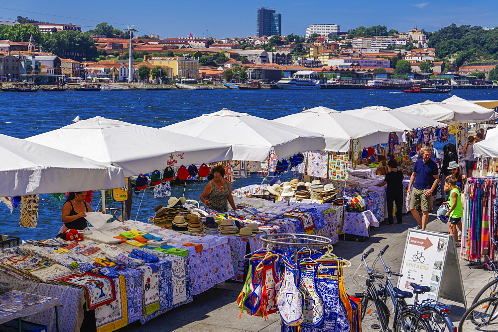 Open air street stalls and markets with cork and gift products on Douro River bank in Ribeira District, Porto, Portugal, Europe - 1278-157