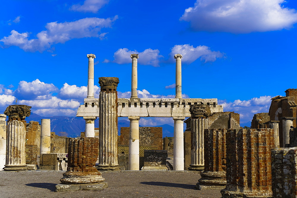 Basilica remains, ancient ruins with standing columns surrounding the Forum area, Pompeii, UNESCO World Heritage Site, Campania, Italy, Europe