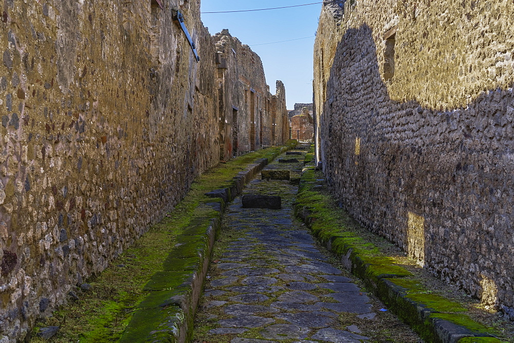 Pompeii stone street with raised blocks. City street with stepping stones allowing vehicles and pedestrians to cross the street. - 1278-79