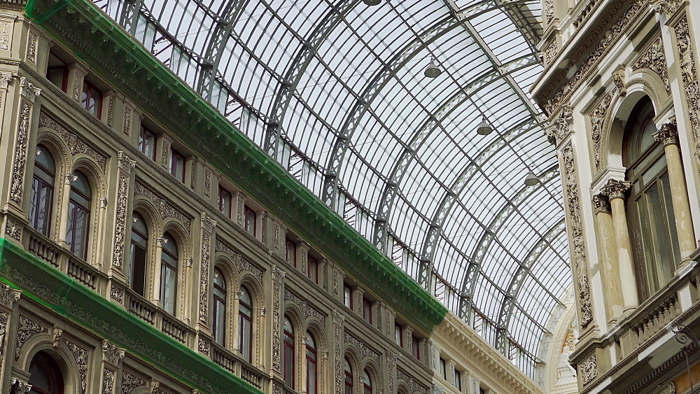 Detail of glass-and-iron covered 19th century shopping gallery housing shops and cafes, Galleria Umberto I, Naples, Campania, Italy, Europe