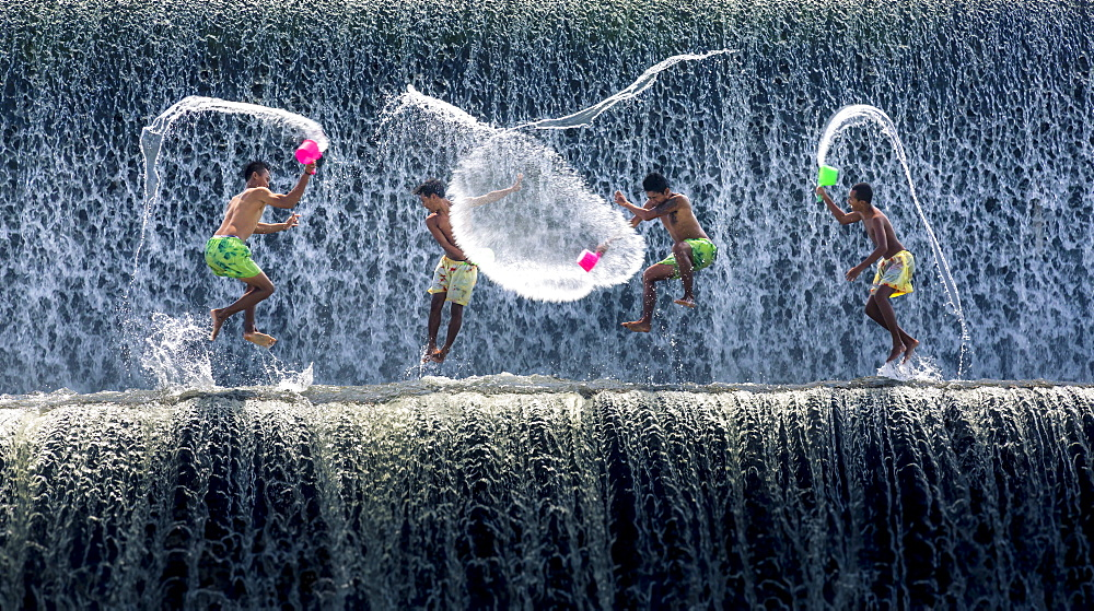 Boys water fight, Tukad Unda dam, Bali, Indonesia, Southeast Asia, Asia - 1282-5