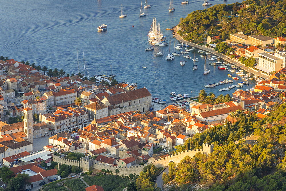 High-angle view over the port and the old town of Hvar Town at sunrise, Hvar, Croatia, Europe